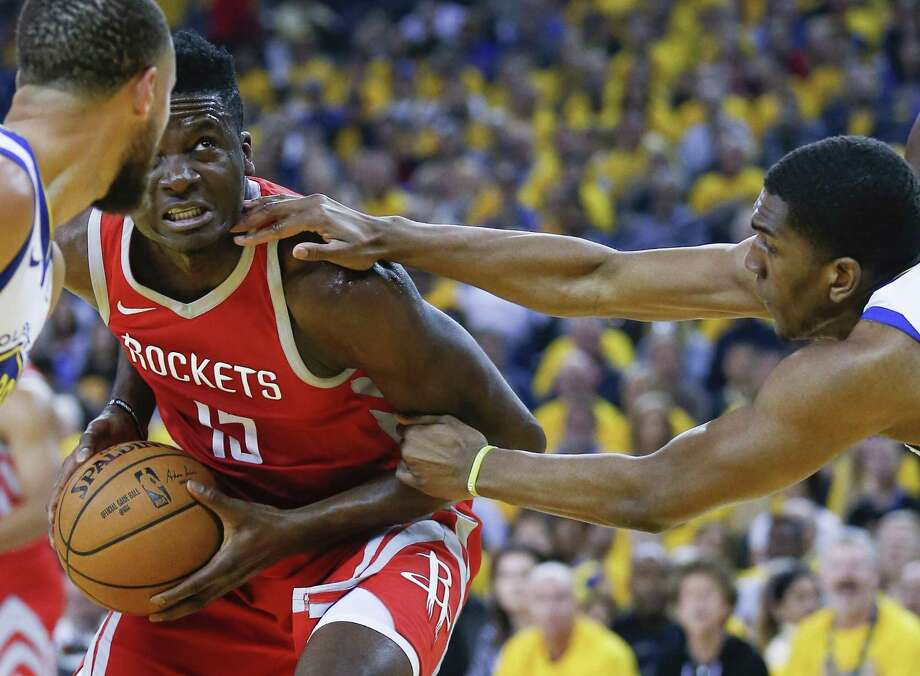 Clint Capela, left, being hounded by Warriors forward Kevon Looney, is a restricted free agent, meaning the Rockets can match any offer he receives from another team. Photo: Michael Ciaglo, Houston Chronicle / Houston Chronicle / Michael Ciaglo
