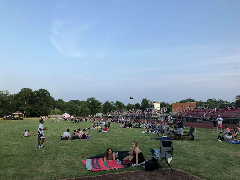 Local residents gathered for the annual New Haven fireworks display on Independence Day Wednesday at Wilbur Cross High School. Photo: Ben Lambert / Hearst Connecticut Media