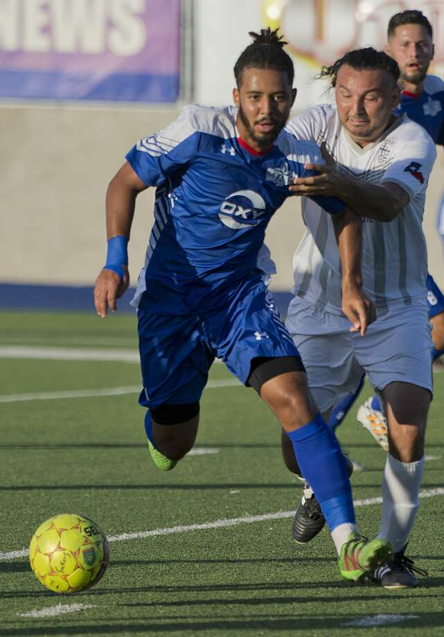 Sockers' Fernandes Melvrik tries to get away from Houston Regals' David Perez 07/04/18 evening at Grande Communications Stadium. Photo: Tim Fischer/Midland Reporter-Telegram