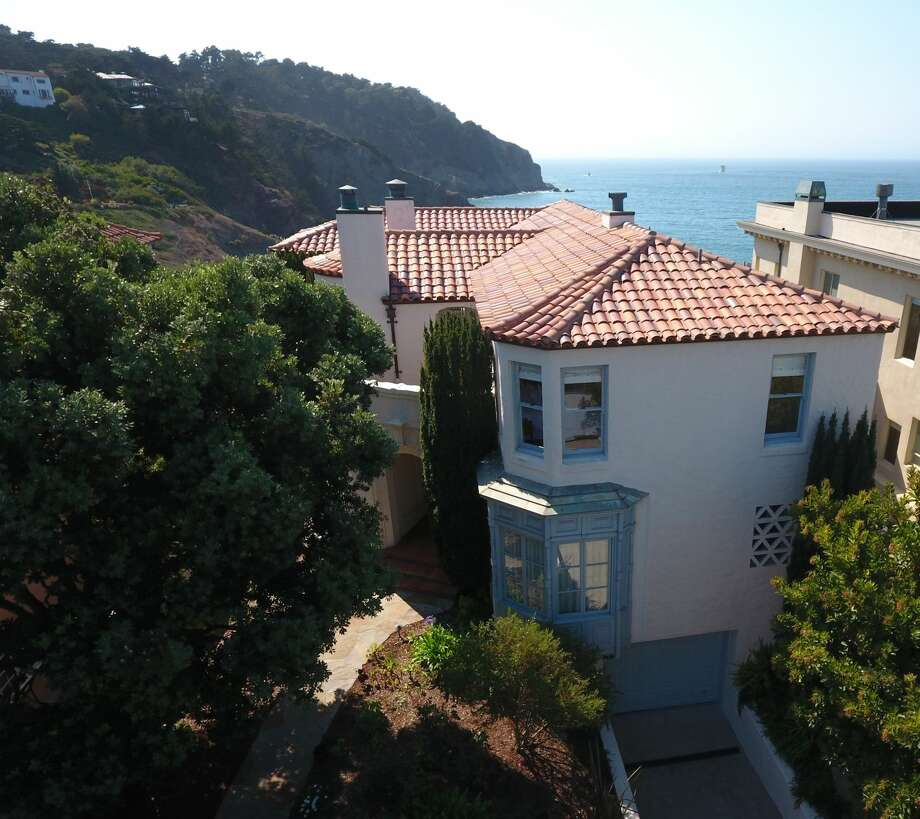 This elegant 1926 Spanish Colonial at 320 Sea Cliff Ave. overlooks China Beach and the ocean. Photo: Alejandro Velarde