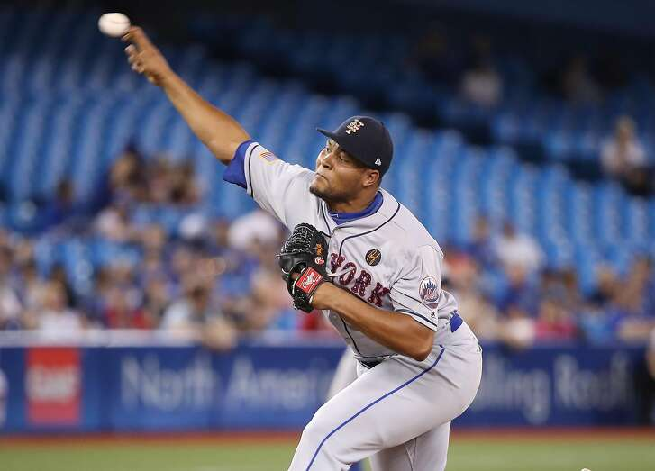 TORONTO, ON - JULY 4: Jeurys Familia #27 of the New York Mets delivers a pitch in the ninth inning during MLB game action against the Toronto Blue Jays at Rogers Centre on July 4, 2018 in Toronto, Canada. (Photo by Tom Szczerbowski/Getty Images)