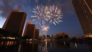Fireworks light up the sky above Empire State Plaza during New York State's 4th of July Celebration on Wednesday, July 4, 2018, in Albany, N.Y. (Will Waldron/Times Union)