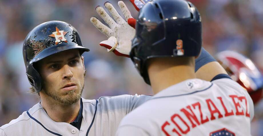 Houston Astros' Josh Reddick, left, is congratulated by Marwin Gonzalez (9) after hitting a two-run home run against the Texas Rangers during the fourth inning of a baseball game Wednesday, July 4, 2018, in Arlington, Texas. (AP Photo/Brandon Wade) Photo: Brandon Wade/Associated Press