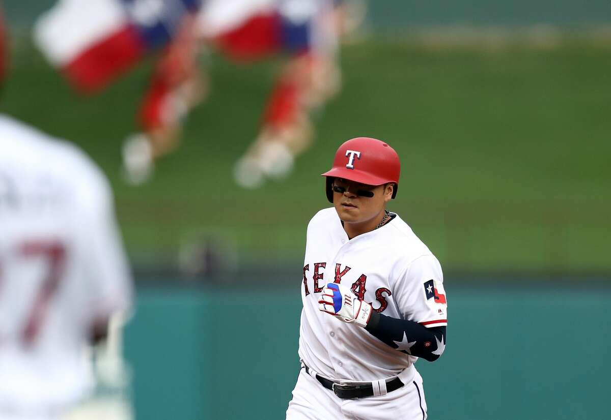 ARLINGTON, TX - JULY 04: Shin-Soo Choo #17 of the Texas Rangers runs the bases after hitting a homerun against the Houston Astros at Globe Life Park in Arlington on July 4, 2018 in Arlington, Texas. (Photo by Ronald Martinez/Getty Images)