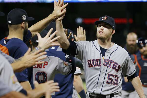 Houston Astros relief pitcher Ken Giles (53) is congratulated by teammates after the team's baseball game against the Texas Rangers, Wednesday, July 4, 2018, in Arlington, Texas. Houston won 5-4 in 10 innings. (AP Photo/Brandon Wade)