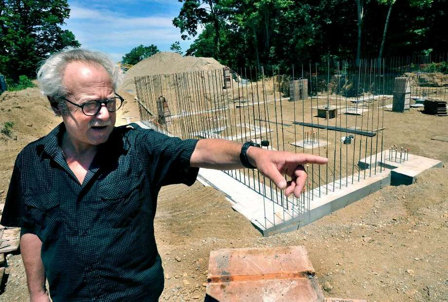 SPECTRUM/Michael-John Cavallaro, vice chairman of the conservation commission in New Milford, talks about the Indian field on Fort Hill, on Sunday, July 4, 2010. The site is being developed for affordable housing. Photo: Michael Duffy / The News-Times