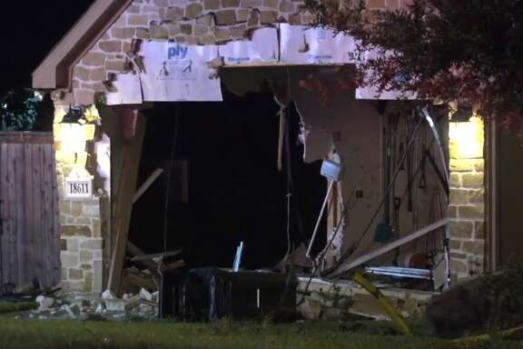 A man drove a truck through a home on Bluffview in Crosby, on Wednesday, July 4, 2018.