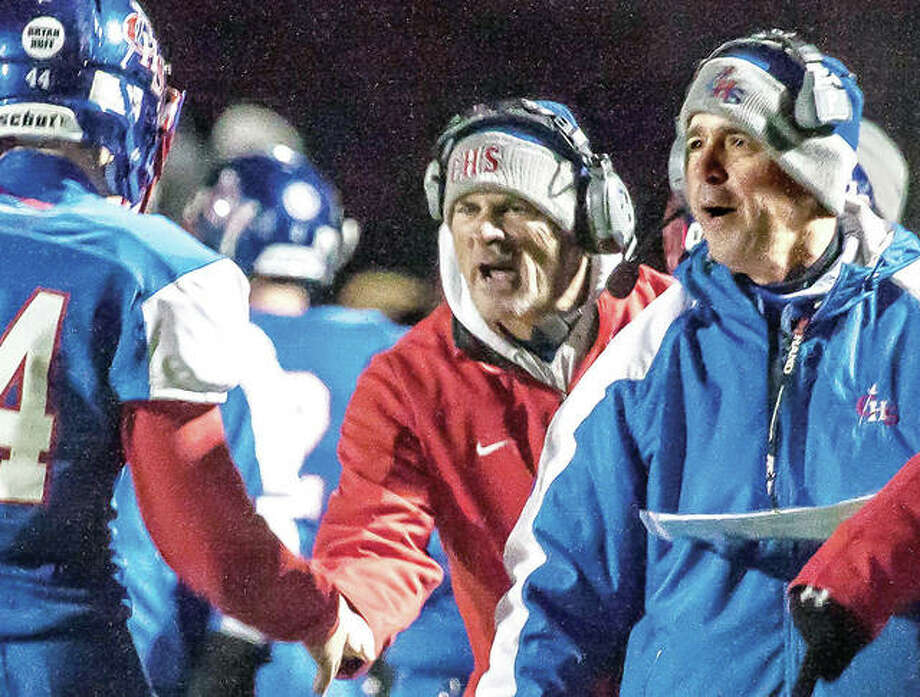 Carlinville head coach Chad Easterday (right) and assistant Don Borgini welcome linebacker Garrett Campbell off the field after a defensive stop in last season's Class 3A playoff victory over EA-WR in Carlinville. Easterday is the 2017 Telegraph Small-Schools Coach of the Year for a second successive season. Photo:       Nathan Woodside / Telegraph File Photo