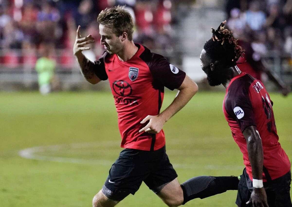 San Antonio FC's Alex Bruce (left) celebrates his tying goal with teammate Omar Gordon.