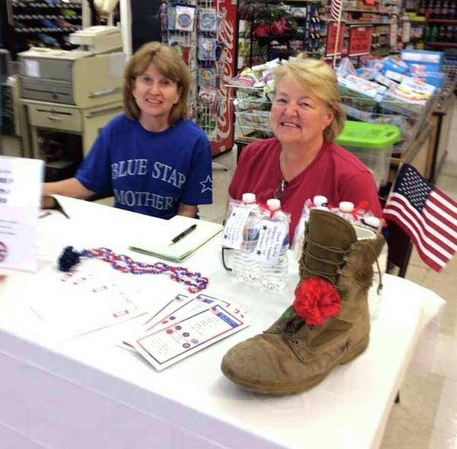 Thumb Chapter 178 of the Blue Star Mothers hosted a successful Fill the Boot drive at McDonald's Food and Family Center in May. All money received will be used for postage and buying items to send to the military troops in the summer. The mom handed out bottled water to shoppers. Pictured are Thumb Chapter President Marcia Janek (left) and Lynne Tschirhart. (Submitted Photo)