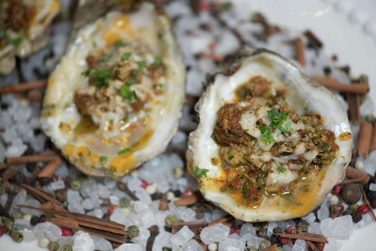 The Houstonian Hotel, Club & Spa will open a new restaurant, Tribute, in fall 2018. It replaces the former Olivette. Shown: Wood grilled oysters with chorizo, parmesan and garlic butter from the new menu.