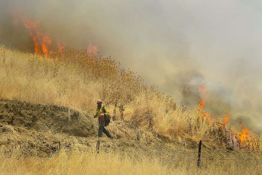 Hot Shot crews from Mendocino use backfires to help contain the County Fire along Highway 129 near Lake Berryessa in Yolo County, California, Tuesday, July 3, 2018. (Randall Benton/The Sacramento Bee via AP) Photo: Randall Benton / Associated Press