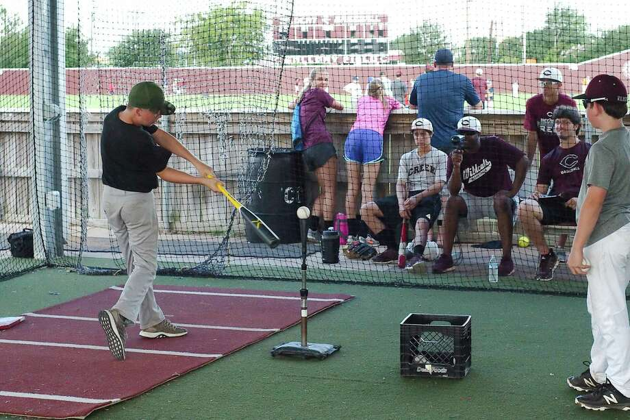 Clear Creek baseball coach Jarwyn Dixon uses a radar gun to measure the bat speed as Aiden McNamara participates in a hitting velocity challenge at the Clear Creek summer baseball camp. Photo: Kirk Sides / Houston Chronicle / © 2018 Kirk Sides / Houston Chronicle