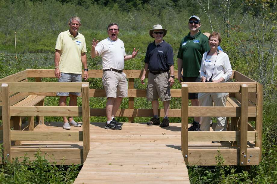 Residents, advocates and state and local officials explore the new Beaver Brook Marsh boardwalk in Barkhamsted. From left, state Sen. Kevin Witkos, Ralph Scarpino, FALPS president; Donald Stein, Barkhamsted first selectman; Eric Hammerling, Connecticut Forest & Parks Association executive director; Jean Woolley, president of The Litchfield Hills Audubon Society. Photo: Joseph Lemieux Jr. / All_Rights_Reserved