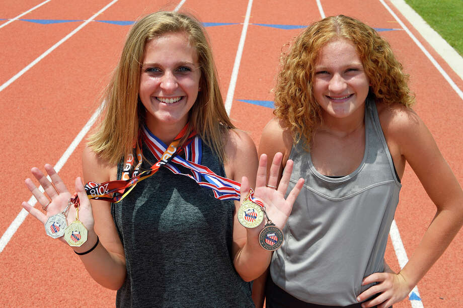 Sisters Maddison Helm, left, and Katelynn Helm have qualified to compete in the Amateur Athletic Union Junior Olympics. Maddison runs the 3,000 and 1,500 meter races, and Katelynn competes in the 400 and 1,500 meter events.  Photo taken Tuesday 7/3/18 Ryan Pelham/The Enterprise Photo: Ryan Pelham/The Enterprise / ?2018 The Beaumont Enterprise