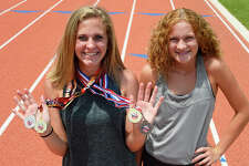 Sisters Maddison Helm, left, and Katelynn Helm have qualified to compete in the Amateur Athletic Union Junior Olympics. Maddison runs the 3,000 and 1,500 meter races, and Katelynn competes in the 400 and 1,500 meter events.  Photo taken Tuesday 7/3/18 Ryan Pelham/The Enterprise