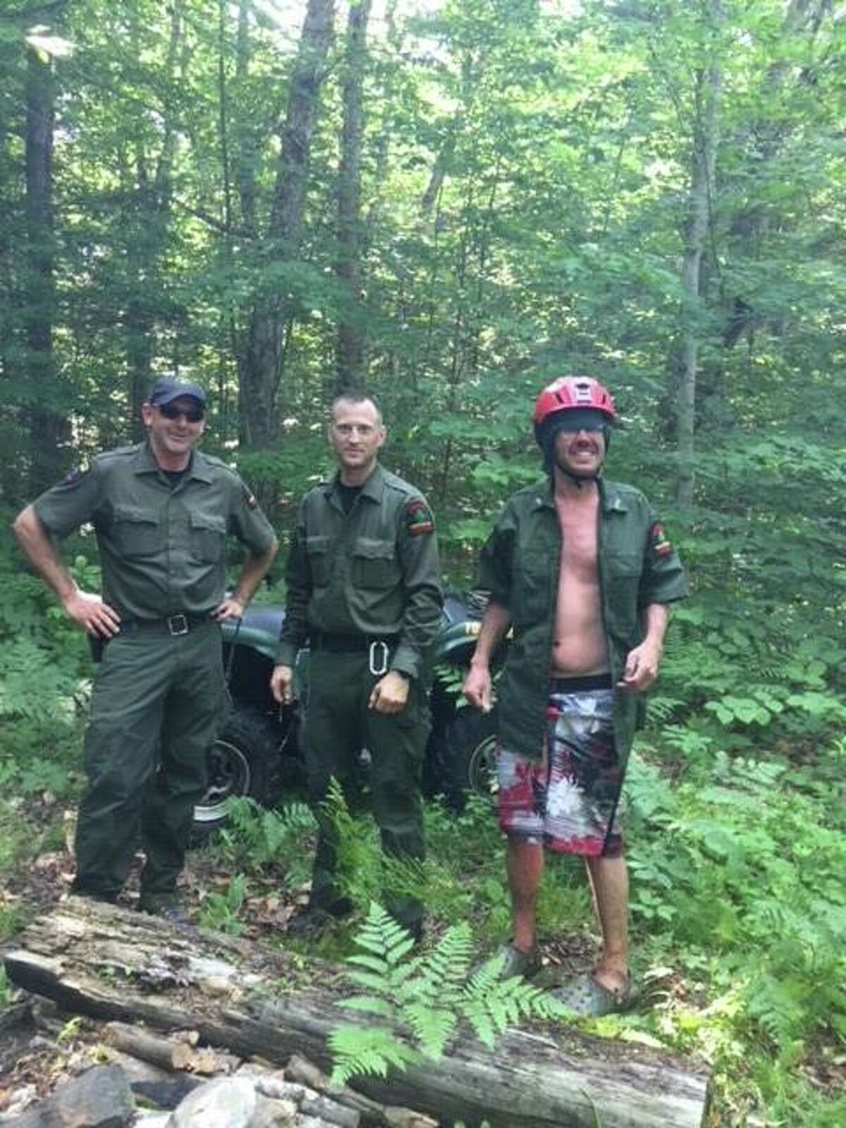 State Department of Environmental Conservation rangers Jay Scott, Evan Donegan, Ian Kerr and Gary Miller joined dozens who helped to find lost hiker Bruce Williams on Monday, July 2, 2018, on Chase Lake in the town of Bleecker, Fulton County. (NYS Department of Environmental Conservation via Facebook)