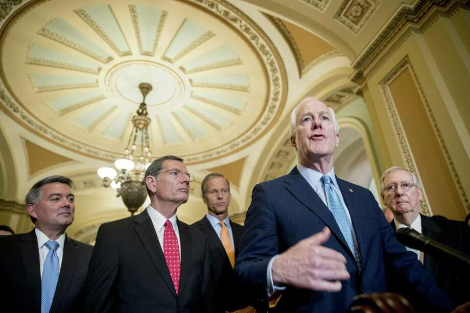Senate Majority Whip Sen. John Cornyn, R-Texas., second from right, accompanied by from right, Sen. Cory Gardner, R-Colo., Sen. John Barrasso, R-Wyo., Sen. John Thune, R-S.D., and Senate Majority Leader Mitch McConnell of Ky., speaks with reporters following a closed door luncheon on Capitol Hill in Washington, Tuesday, June 26, 2018. (AP Photo/Andrew Harnik) Photo: Andrew Harnik, STF / Associated Press / Copyright 2018 The Associated Press. All rights reserved.