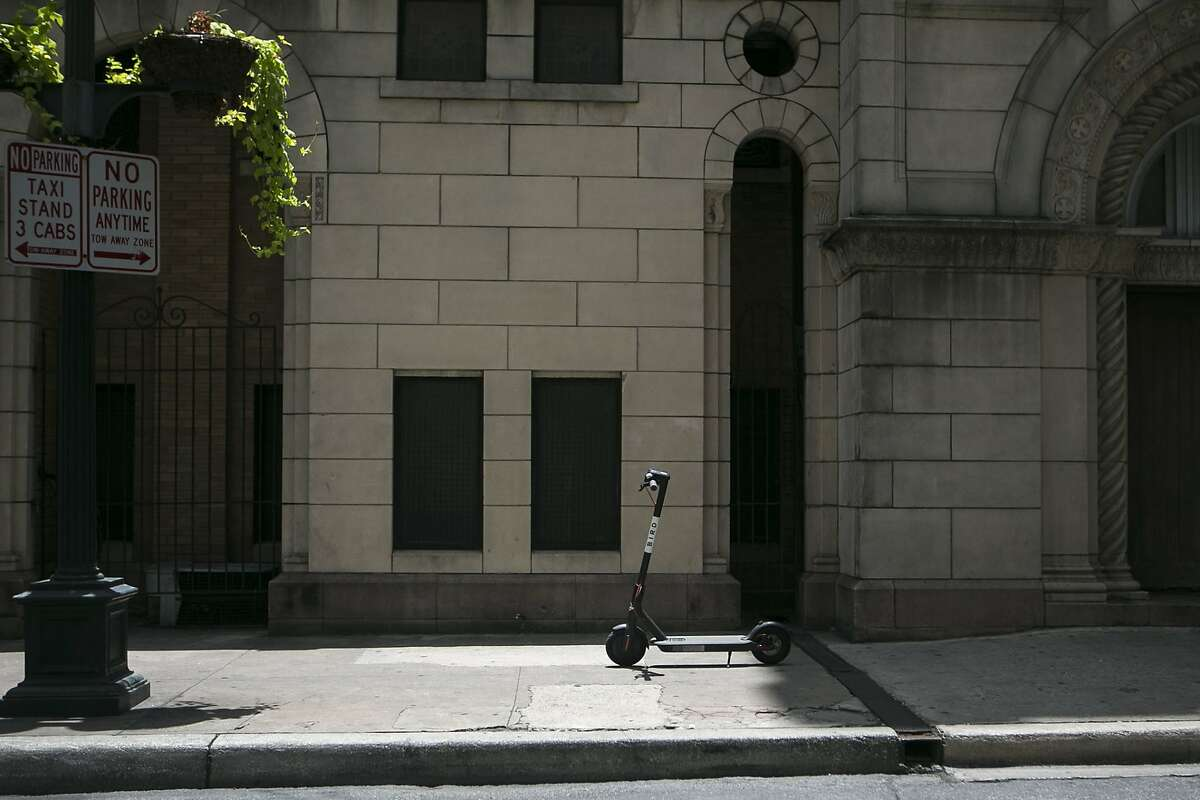 An electric Bird sits outside St. Mary's Catholic Church in downtown San Antonio on July 1, 2018. The city didn't know about the recent deployment of the devices, which can be left anywhere, but is working quickly to develop regulations.