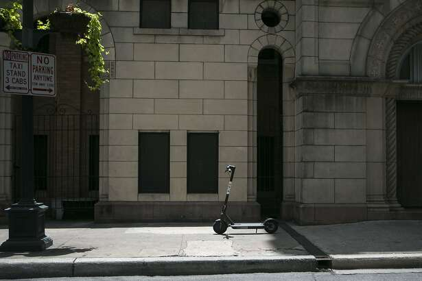 An electric Bird sits outside St. Mary's Catholic Church in downtown San Antonio July 1, 2018. There are around 150 Bird electric scooters deployed downtown, in Dignowitty Hill, Government Hill and Southtown. Anyone can use them by downloading the Bird app and paying $1 plus $0.15 per minute. The city didn't know about the recent deployment of the devices, which can be left anywhere, but is working quickly to develop regulations.