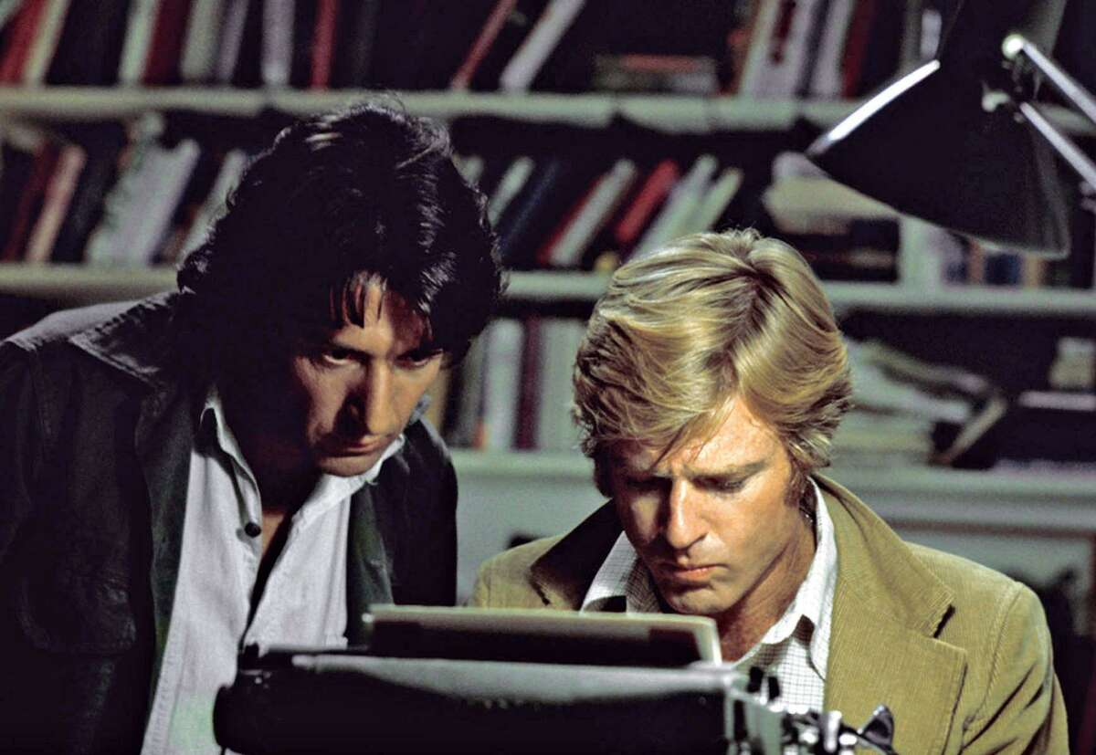 """Actors Robert Redford (right) and Dustin Hoffman appear in their roles as reporters Bob Woodward and Carl Bernstein, respectively, in the 1976 film """"All the President's Men."""""""