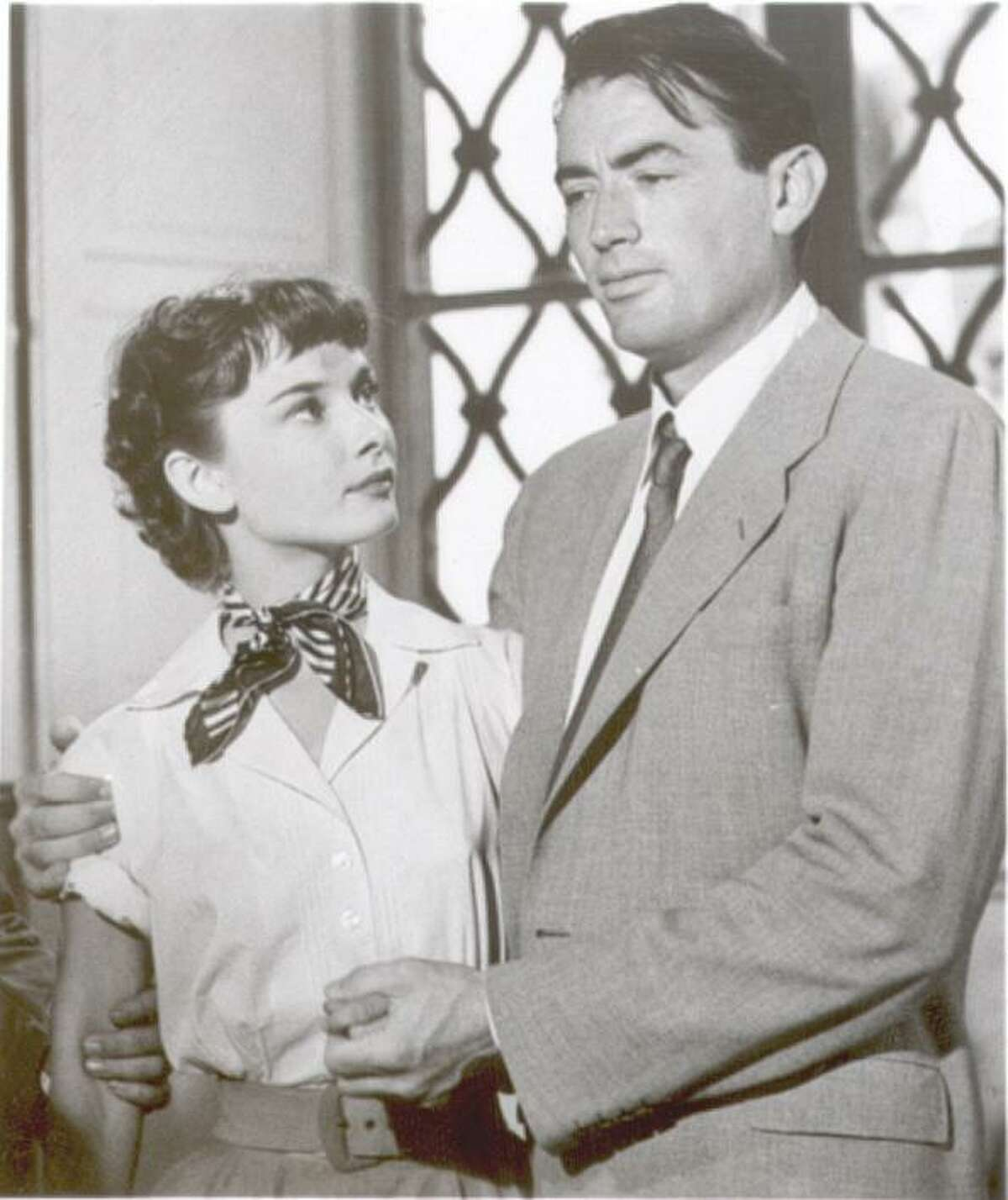 """Audrey Hepburn and Gregory Peck in a scene from """"Roman Holiday."""""""