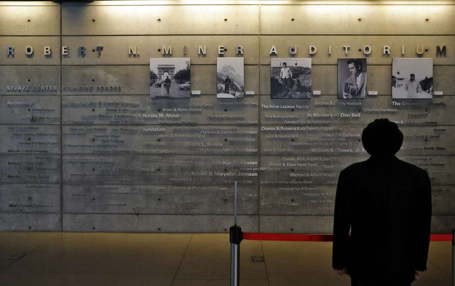 A man looks up at the wall of sponsors for the Robert N. Miner Auditorium at the SFJazz Center. It took 18 months to build the venue designed specifically for jazz, but now, the center in San Francisco has become a destination. Photo: Carlos Avila Gonzalez / The Chronicle / Carlos Avila Gonzalez - San Francisco Chronicle