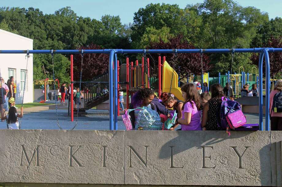 Students at McKinley School hung out at the playground Thursday, the first day of school, while waiting for the bell to ring. Fairfield,CT. 8/31/17 Photo: Genevieve Reilly / Hearst Connecticut Media / Fairfield Citizen