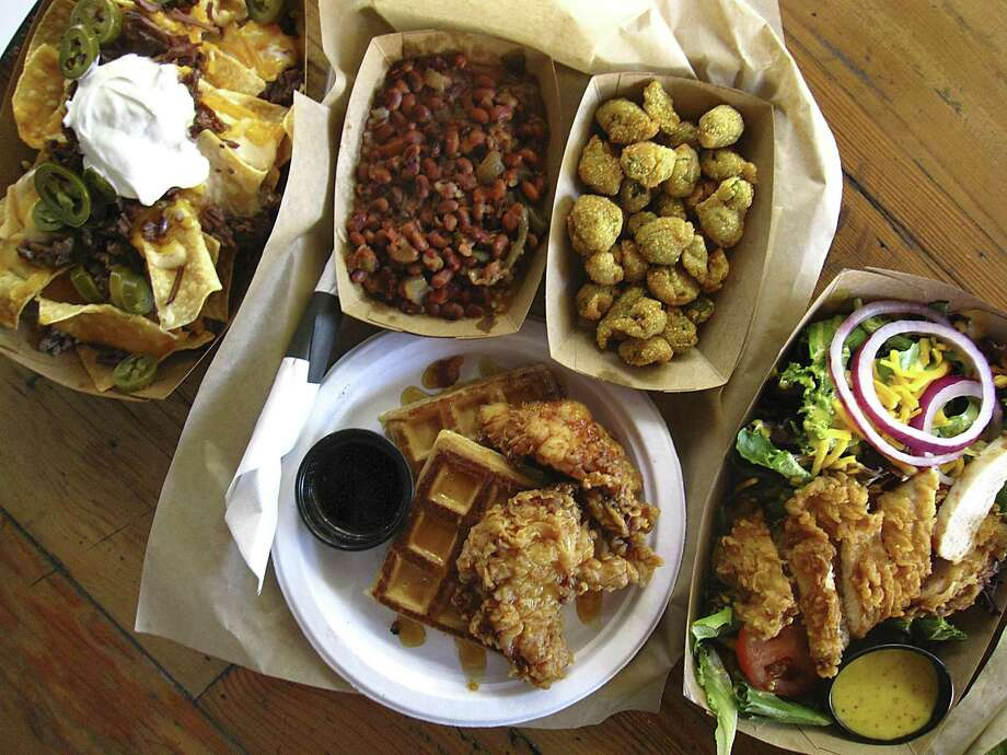 A roundup of food from Hoppin' John, a Southern-style restaurant at The Vistana. Clockwise from top left: brisket nachos, hoppin' John, fried okra, chicken and waffles and a hot chicken salad. For Mike Sutter's review Photo: Mike Sutter /San Antonio Express-News