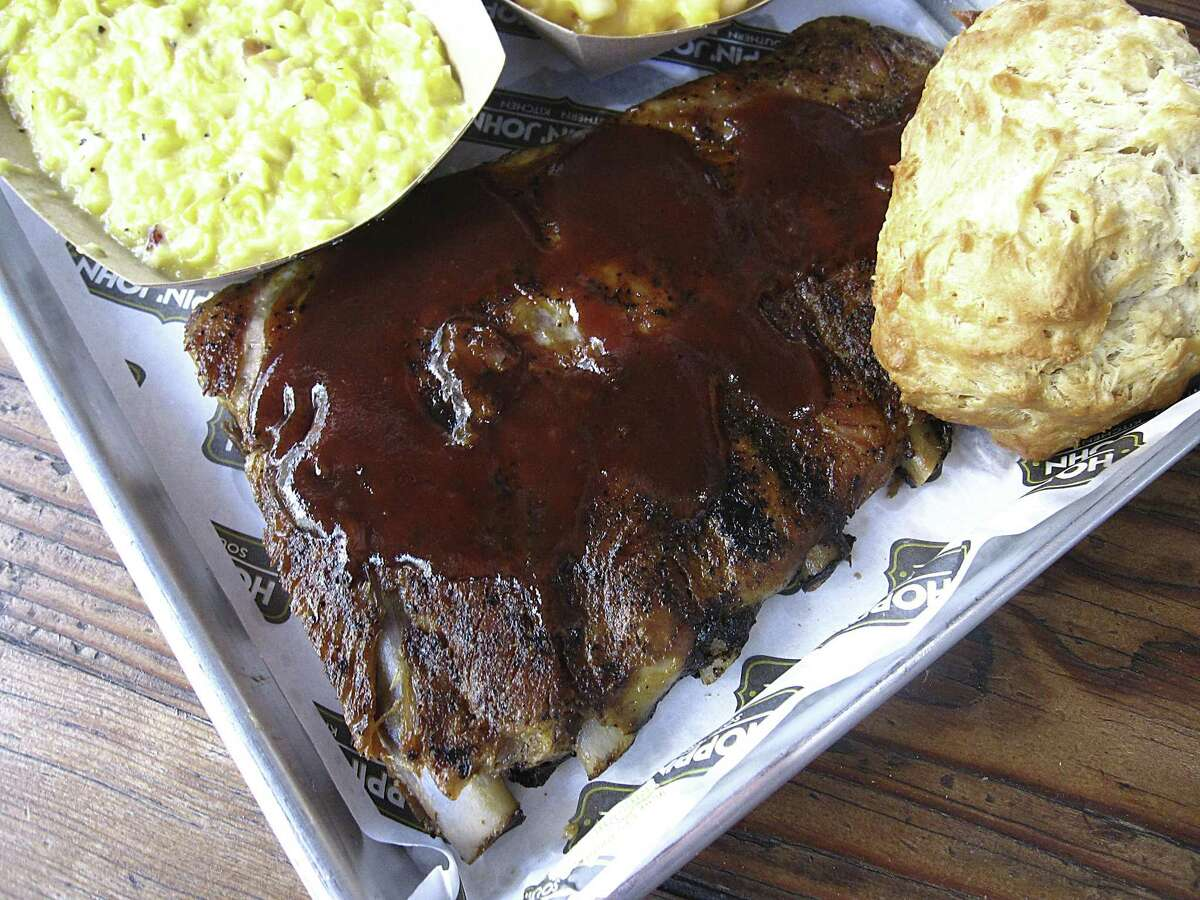 Pork spare ribs with barbecue sauce, a biscuit, creamed corn and mac and cheese from Hoppin' John.