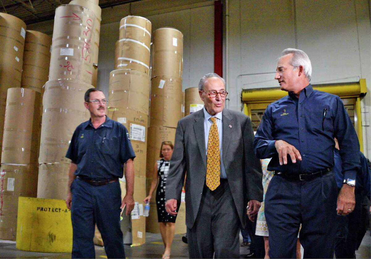 U.S. Senator Charles E. Schumer, center, gets a tour of the Quad Graphics facility from its chairman, president and CEO Joel Quadracci and press room manager Chuck Clark, left, Thursday July 5, 2018 in Saratoga Springs, NY. (John Carl D'Annibale/Times Union)