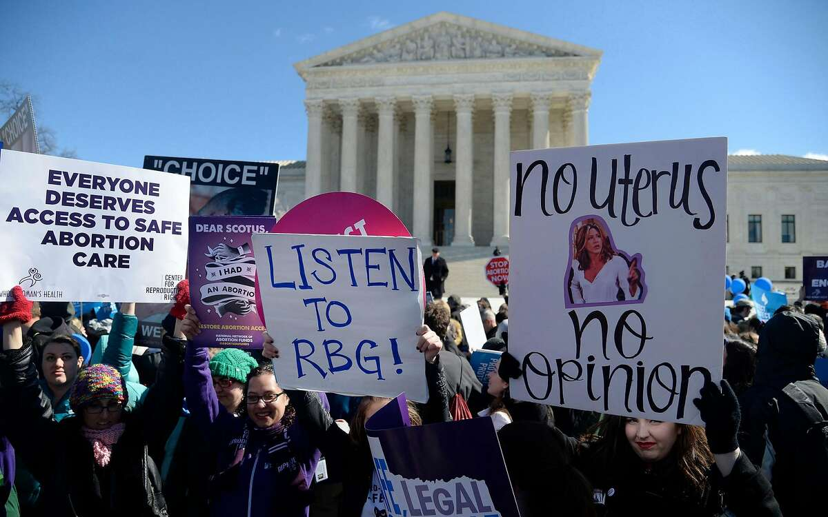 Supporters of legal access to abortion, as well as anti-abortion activists, rally outside the Supreme Court on March 2, 2016, in Washington, D.C. (Olivier Douliery/Abaca Press/TNS)