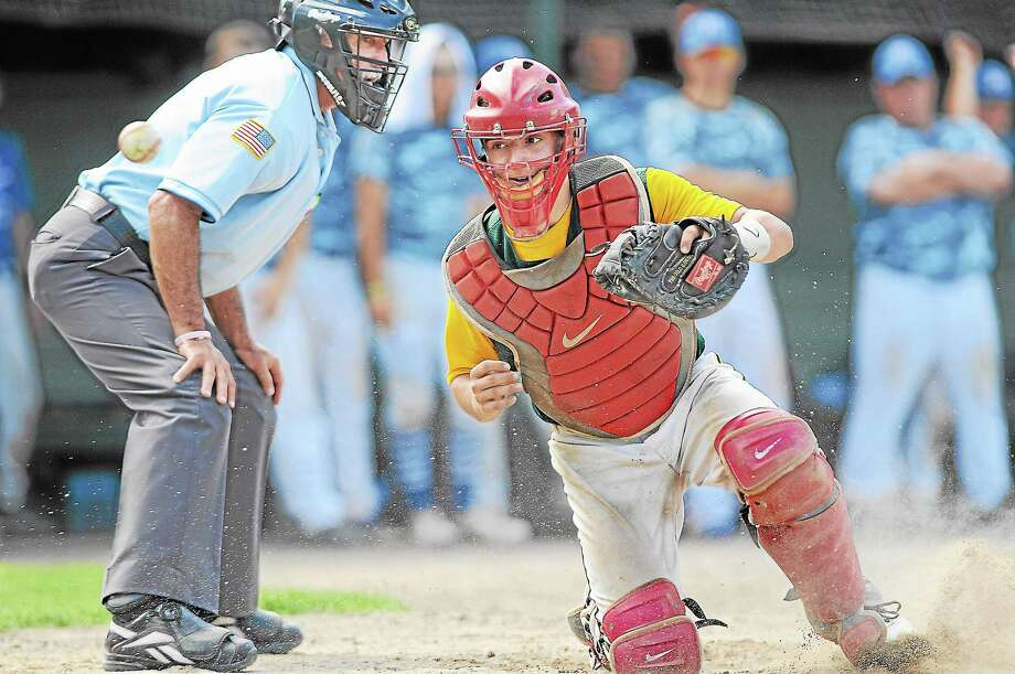 Rocky Hill, Cromwell and Portland catcher Kevin Radziewicz chases down a wild pitch by Jake Regula in the bottom of the seventh inning, allowing Middletown Post 75 center fielder Anthony Marino to score the tying run in the American Legion's Norm Way Memorial Classic Baseball consolation game last year at Palmer Field. Photo: File Photo / TheMiddletownPress