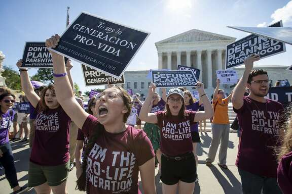 Pro-life and anti-abortion advocates demonstrate in front of the Supreme Court early Monday, June 25, 2018. The justices are expected to hand down decisions today as the court's term comes to a close. They are waiting a decision from the justices on crisis pregnancy centers, the facilities established by pro-life organizations around the country to counsel women against abortion. (AP Photo/J. Scott Applewhite)
