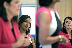 Jahana Hayes listening to Mary Glassman, left, and Glassman listening to Hayes, right, during a candidates' forum in May. Hayes is challenging Glassman in an Aug. 14 Democratic primary for the 5th District.