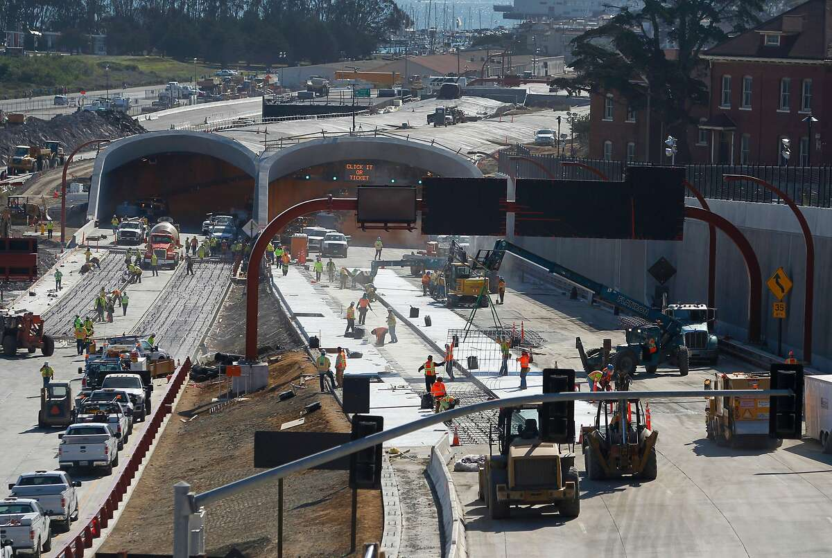 Construction crews race against the clock to realign the Presidio Parkway project into its permanent configuration in San Francisco, Calif. on Saturday, July 11, 2015.