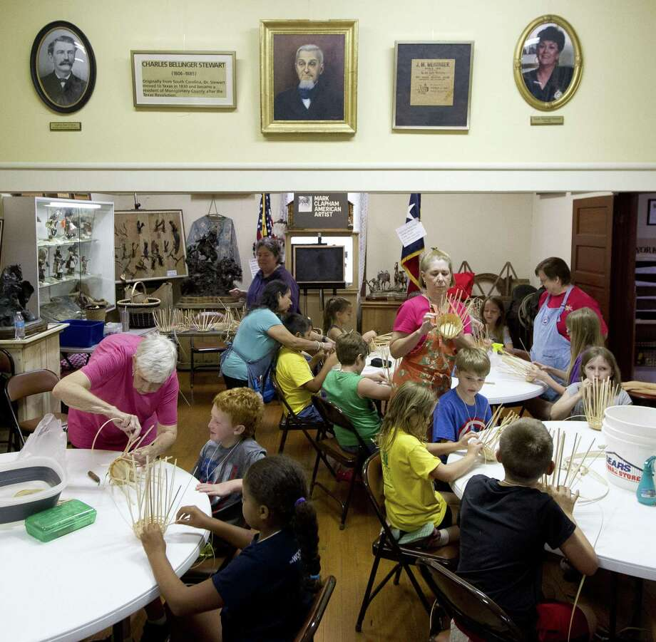 Campers receive instruction on basket weaving during the annual Pioneer Camp at the Heritage Museum of Montgomery County, Wednesday, July 19, 2017, in Conroe. Area children ages 8 to 11 learn from volunteers about early life in America and the history of the county during the two-week camp. This year's camp begins on Monday and there are still a few spots open. Photo: Jason Fochtman, Staff Photographer / Houston Chronicle / © 2017 Houston Chronicle