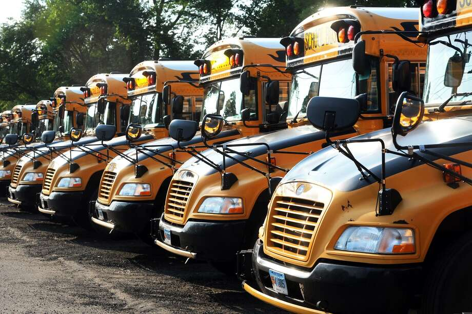 City of Shelton school buses parked in Shelton, Conn. June 7, 2018. Photo: Ned Gerard / Hearst Connecticut Media / Connecticut Post