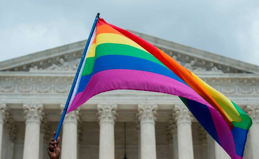 An upside down rainbow flag flys outside the U.S. Supreme Court in Washington, D.C.