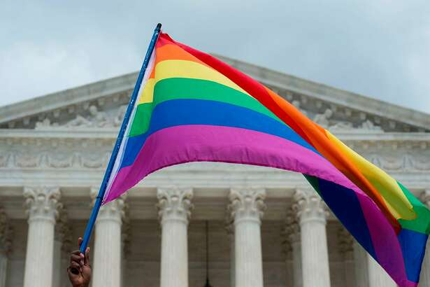 (FILES) In this file photo taken on June 26, 2015 a rainbow flag is flown outside the Supreme Court in Washington, DC. The US Supreme Court on June 25, 2018 ordered a lower court to reconsider the case against a Washington state florist who was fined for refusing to sell flowers for a same-sex wedding on religious grounds. The decision follows the top US court's June 4 ruling in favor of a Colorado baker who had been found guilty of discrimination for refusing to bake a wedding cake for a gay couple on the basis of his Christian beliefs. / AFP PHOTO / MOLLY RILEYMOLLY RILEY/AFP/Getty Images