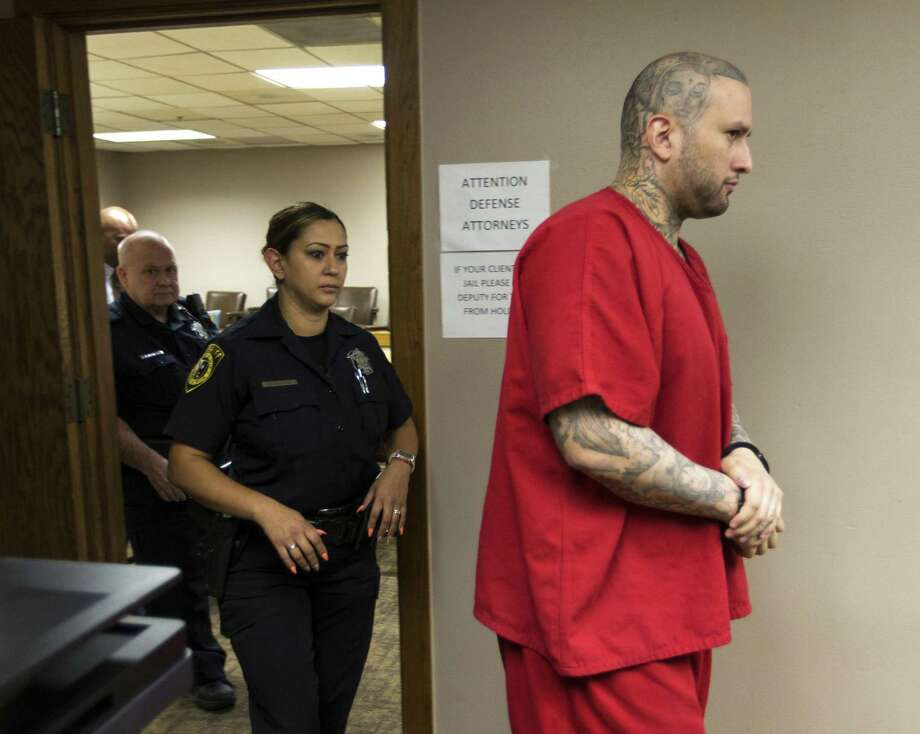 Capital murder suspect Brian Flores, right, leaves the courtroom Thursday, July 5, 2018 after a mistrial was declared in his case. Flores sought the mistrial on the grounds the lead defense attorney in the case, Ed Camara, was not capable of effectively defending Flores after Camara suffered a concussion from a fall. Photo: William Luther, Staff / San Antonio Express-News / © 2018 San Antonio Express-News