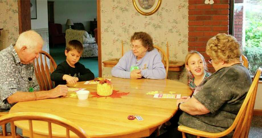 Laker Elementary second graders play bingo with Country Bay residents as part of the Generation Connection program. (Submitted Photo)