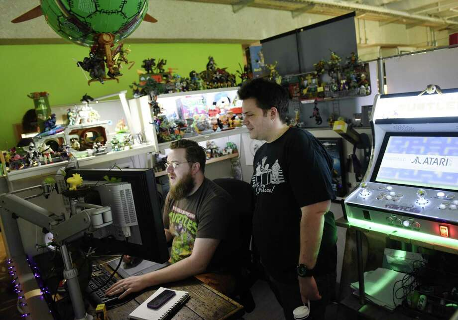 Animators Brock Boyts (left) and John Lavin at work in May 2017 at Blue Sky Studios in Greenwich, Conn. Under an agreement in which it denied colluding with other studios to align wages, Blue Sky makes the first of two payments totaling $5.9 million to animators in July 2018 as part of a $170 million industrywide settlement involving Dreamworks, Walt Disney and subsidiaries Pixar and Lucasfilm, and other animators. Photo: Tyler Sizemore / Hearst Connecticut Media / Greenwich Time