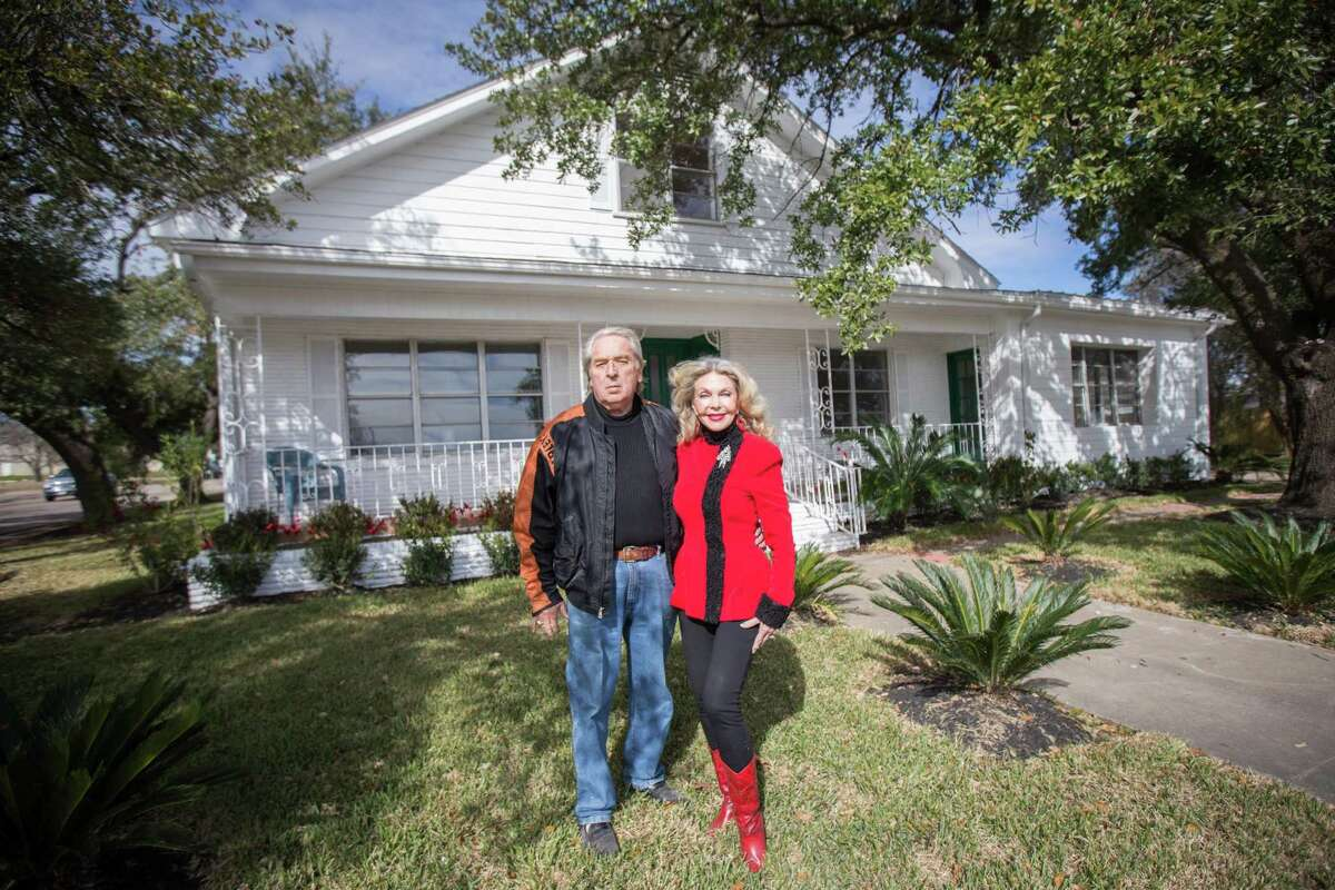 Carl and Lyn Howard pose for a portrait in front of the historic Isaac Conroe house on Friday, Jan. 5, 2017. They restored the home and then sold it to the City of Conroe.
