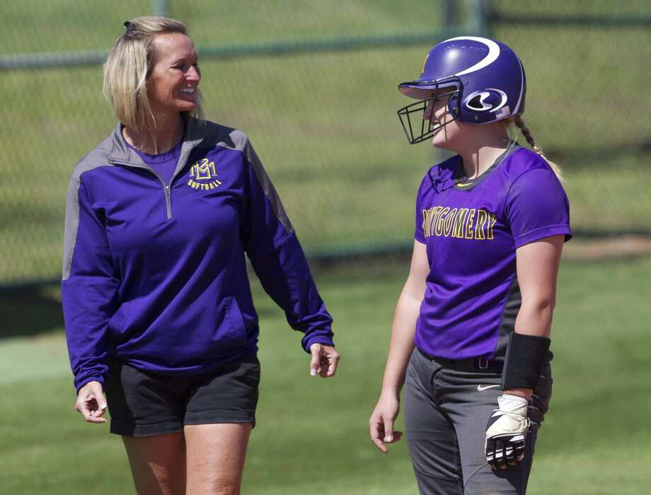 Montgomery's Rylee Hazlewood, right, jokes with head coach Michelle Rochinski. Rochinski will be the first softball coach at the new Lake Creek High School. Photo: Jason Fochtman, Staff Photographer / Houston Chronicle / © 2018 Houston Chronicle