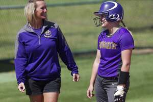 Montgomery's Rylee Hazlewood, right, jokes with head coach Michelle Rochinski. Rochinski will be the first softball coach at the new Lake Creek High School.