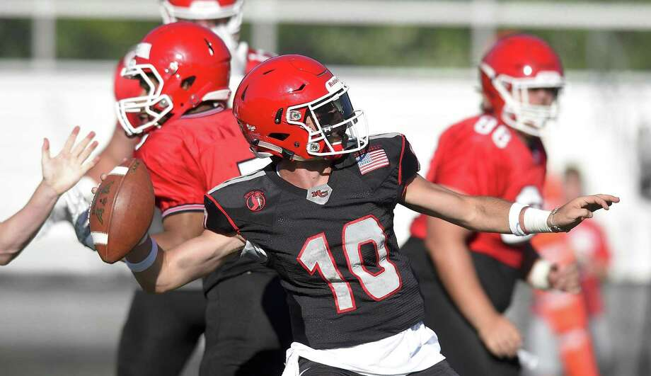New Canaan quarterback Drew Pyne throws a pass downfield during the 11th Annual Brian Wilderman Memorial Red and White football game at Dunning Stadium in New Canaan on June 15. Photo: Matthew Brown / Hearst Connecticut Media / Stamford Advocate