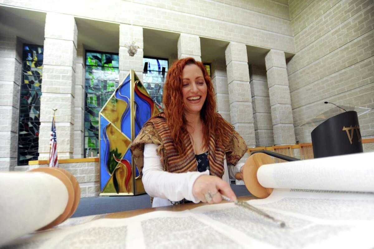 Cantor Sandy Bernstein reads a section of the Torah at Temple Sholom.
