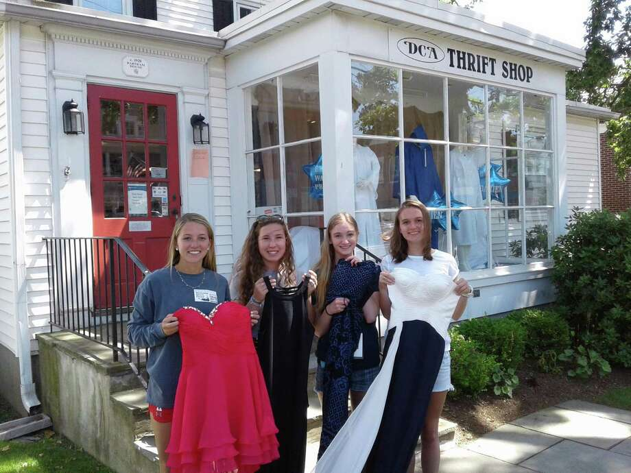 From left, Bella Litt, of Greens Farms Academy, Brielle Racanelli and Katie Chidley, both of Darien High School, and Charlotte Sheehan, of Sacred Heart Greenwich, donate their prom dresses to the Darien Community Association. Photo: Contributed Photo