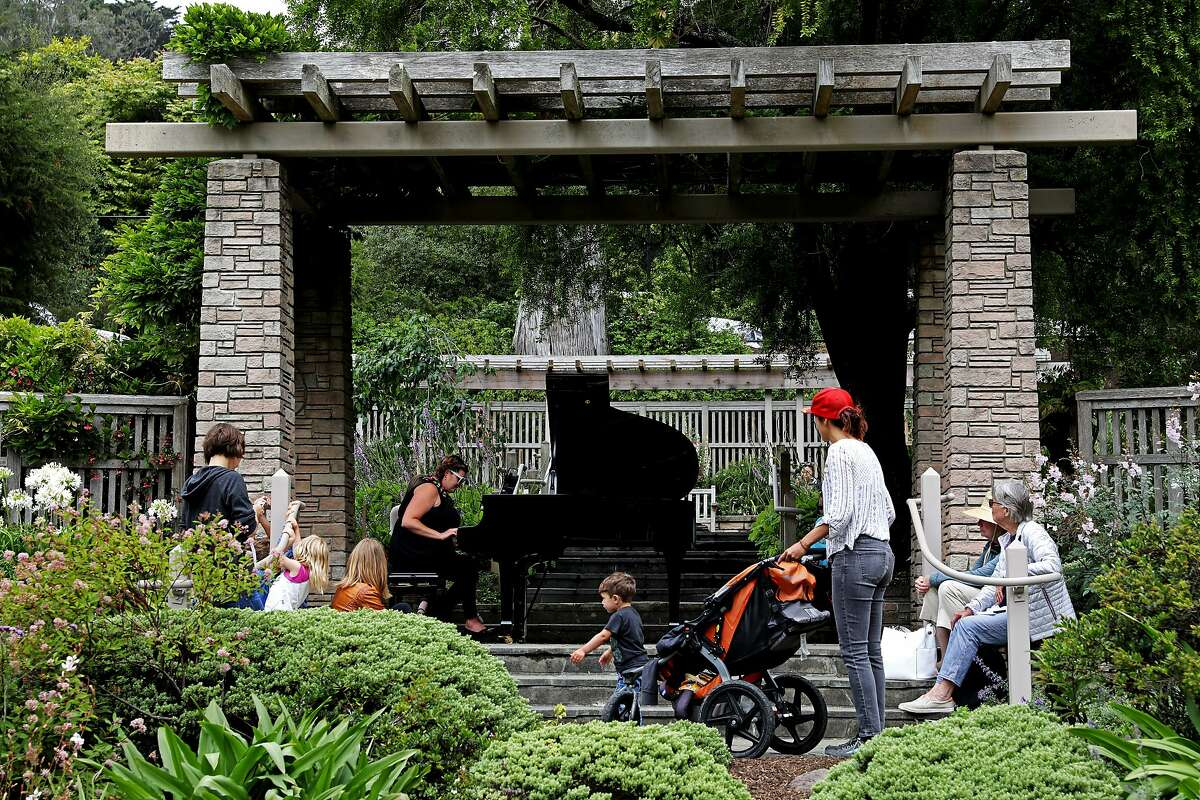 Jennifer Pokas of San Rafael performs a selection on piano in the Zellerbach Garden at the San Francisco Botanic Garden in San Francisco, California on Thursday, July 5, 2018. A dozen pianos are currently scattered around the grounds as part of the annual Flower Piano event running from now through July 16.